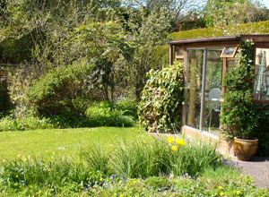 In the Garden there are two sheds, two patios, tables and chairs, an herb garden, a pond, and fruit trees.